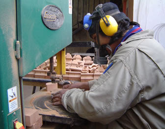 Rodrigo works with a circular saw to craft 3D wooden puzzles in La Paz, Bolivia.