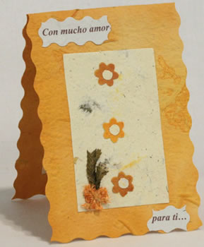 handmade paper card from Peru with flowers in vertical orientation.