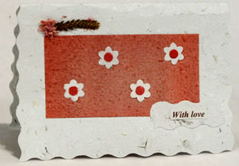 handmade paper card from Peru with flowers in horizontal orientation.
