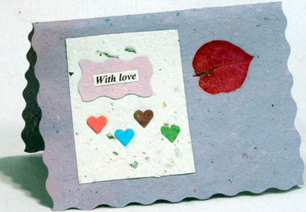 Handmade paper card with hearts.
