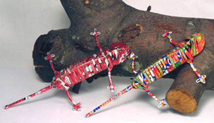 Small chameleons crafted from recycled aluminum cans in Mali, Africa.