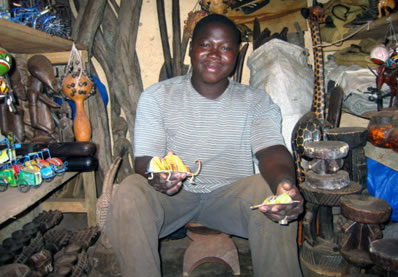 Handicapped artisan who creates chameleons from used cans in Mali, Africa.