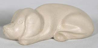 Haitian carved soapstone dog figurine.