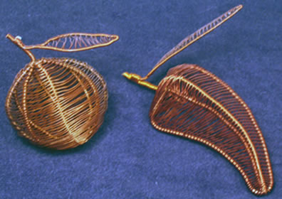 Orange or pepper - fruit created from copper refrigerator wire in Mali, Africa.