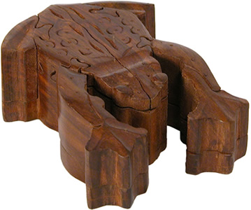 From wooden scraps appears a frog puzzle box carved in India.