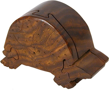 Turtle puzzle box crafted from wood scraps in India.